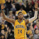 Indiana Pacers forward Paul George reacts to hitting a 3-point shot against the Detroit Pistons during the first half of an NBA basketball game in Indianapolis, Wednesday, April 2, 2014 The Associated Press