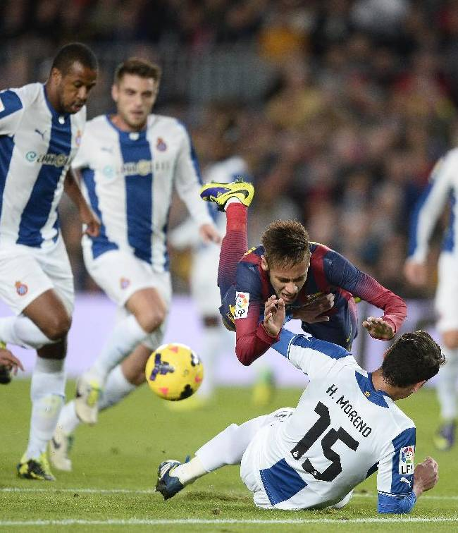 FC Barcelona's Neymar, from Brazil, falls over Espanyol's Hector Moreno, on the ground, during a Spanish La Liga soccer match at the Camp Nou stadium in Barcelona, Spain, Friday, Nov. 1, 2013