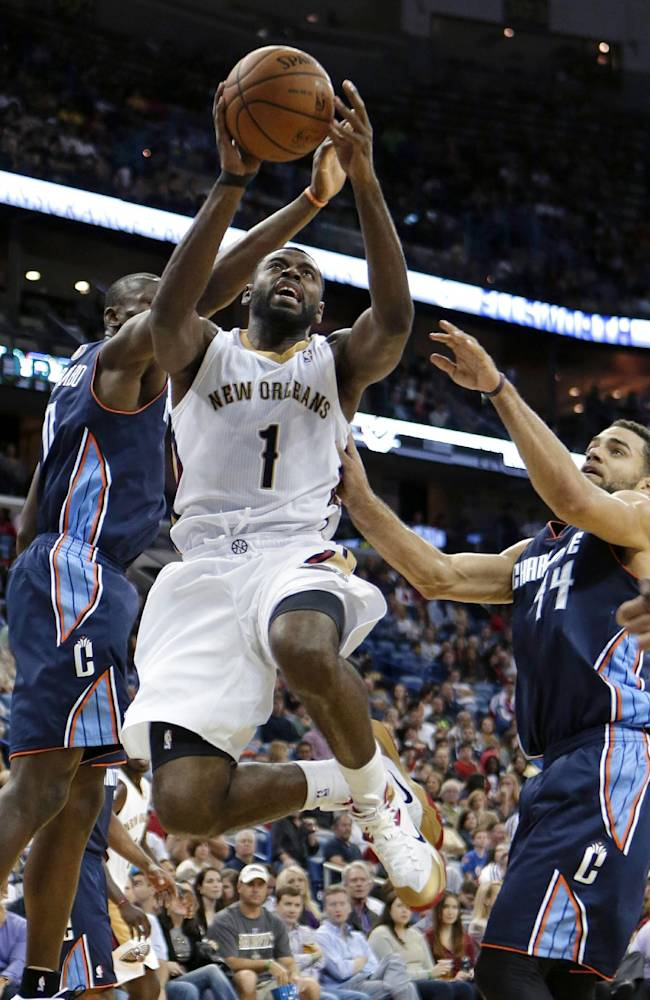 New Orleans Pelicans guard Tyreke Evans (1) drives to the basket between Charlotte Bobcats guard Jeffery Taylor (44) and forward Bismack Biyombo, behind, in the second half of an NBA basketball game in New Orleans, Saturday, Nov. 2, 2013. The Pelicans won 105-84
