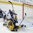 Winnipeg Jets defenseman Mark Stuart (5) takes down Nashville Predators center Olli Jokinen (13), of Finland, in the first period of an NHL hockey game Saturday, Nov. 15, 2014, in Nashville, Tenn. Stuart was called for interference on the play. At left is