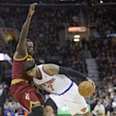 New York Knicks' Carmelo Anthony, right, drives against Cleveland Cavaliers' Luol Deng during an NBA basketball game Saturday, March 8, 2014, in Cleveland. Anthony scored a team-high 26 points in New York's 107-97 win over Cleveland The Associated Press