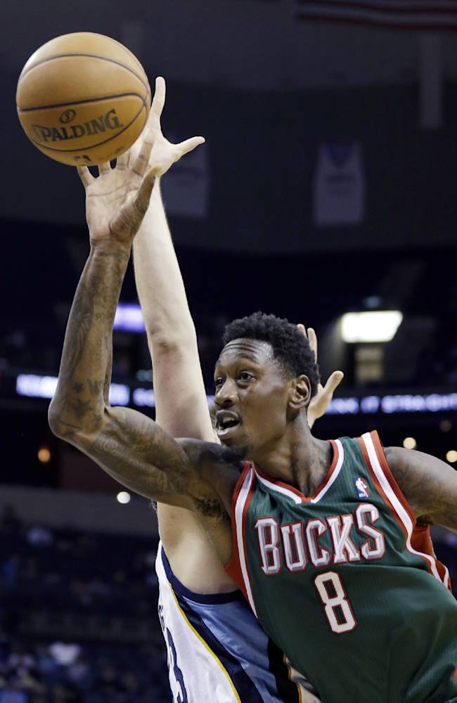 Milwaukee Bucks' Larry Sanders (8) shoots in front of Memphis Grizzlies' Marc Gasol, of Spain, during the first half of an NBA preseason basketball game in Memphis, Tenn., Tuesday, Oct. 15, 2013