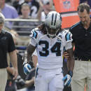 Carolina Panthers running back DeAngelo Williams (34) walks across the field after an injury during the first half of an NFL football game against the Baltimore Ravens in Baltimore, Sunday, Sept. 28, 2014. (AP Photo/Patrick Semansky)