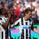 Newcastle United's Shola Ameobi, left, celebrates his goal with teammate Luuk De Jong, right, during their English Premier League soccer match against Swansea City at St James' Park, Newcastle, England, Saturday, April 19, 2014