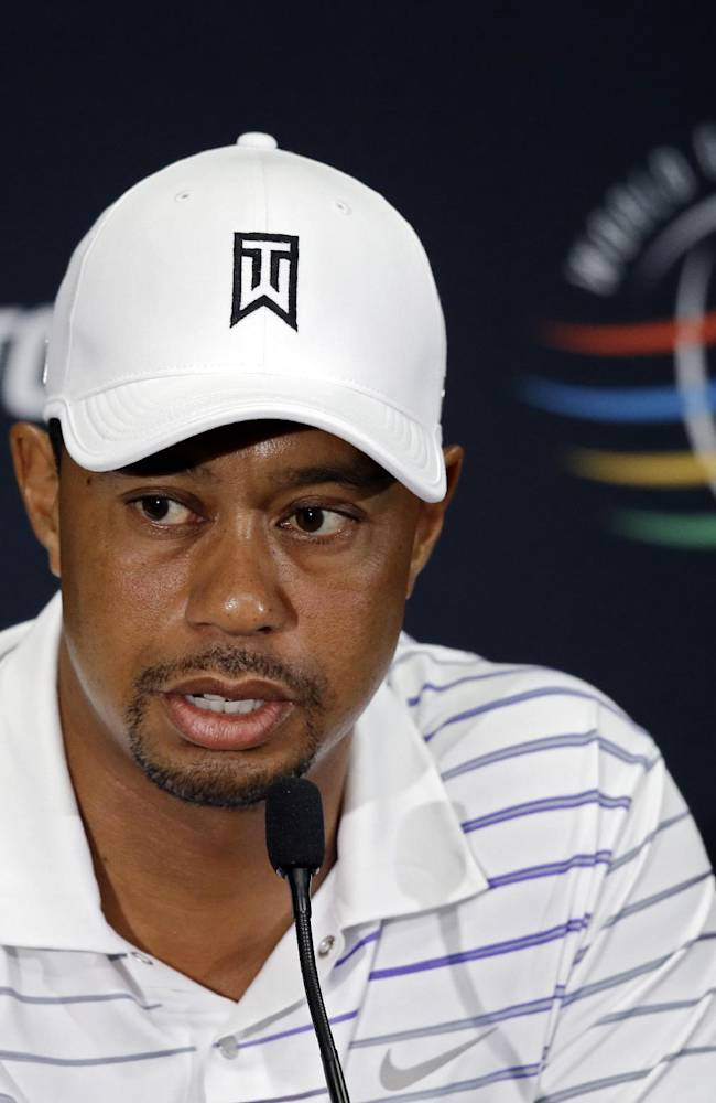 Tiger Woods answers questions at his news conference during the final practice day for the Bridgestone Invitational golf tournament Wednesday, July 30, 2014, in Akron, Ohio