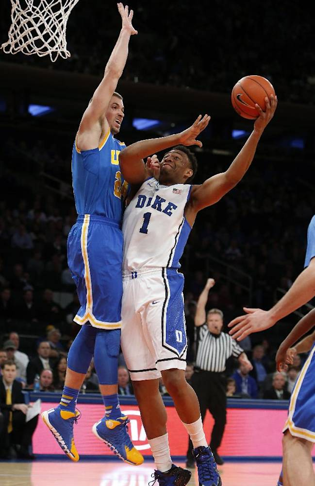 Duke's Jabari Parker (1) shoots against UCLA's Travis Wear (24) during the first half of an NCAA college basketball game, Thursday, Dec. 19, 2013, in New York