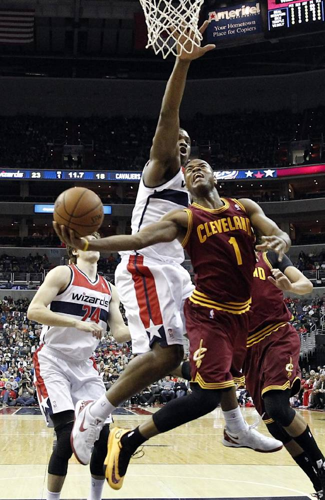 Cleveland Cavaliers guard Jarrett Jack (1) shoots in front of Washington Wizards center Kevin Seraphin, from France, in the first half of an NBA basketball game on Saturday, Nov. 16, 2013, in Washington