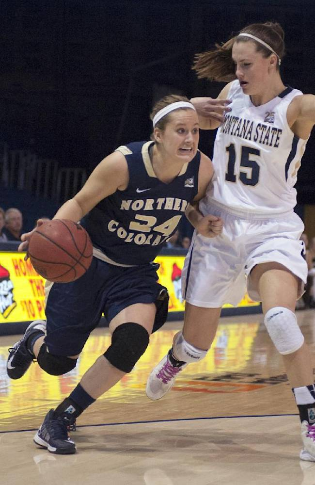 In this photo provided by Montana State University, Northern Colorado guard Kyleigh Hiser (24) drives past Montana State forward Jackie Elliot (15) during the first half of an NCAA college basketball game Saturday, Feb. 15, 2014, in Bozeman, Mont