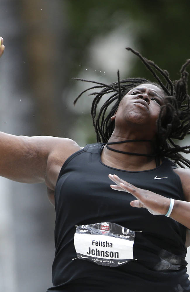 Felisha Johnson makes her throw in the finals  of the Women's Shot Put in USA Track and Field Championships in Sacramento Calif., Wednesday, June 25, 2014.  Johnson finished second with a throw of 62 feet 11  and one quarter inches