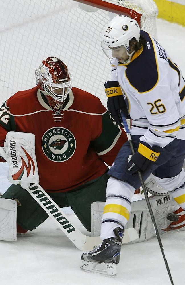 Minnesota Wild goalie Niklas Backstrom (32), of Finland, deflects a shot with his pad under Buffalo Sabres left wing Matt Moulson (26) during the first period of an NHL hockey game in St. Paul, Minn., Thursday, Jan. 2, 2014