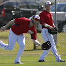Washington Nationals left fielder Bryce Harper catches a fly ball in front of outfielder Nate McLouth during a spring training baseball workout, Thursday, Feb. 20, 2014, in VIera, Fla The Associated Press