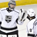 Los Angeles Kings goalie Jonathan Quick and Drew Doughty (8) celebrate the win over the Edmonton Oilers during NHL hockey action in Edmonton, Alberta, on Sunday March 9, 2014 The Associated Press