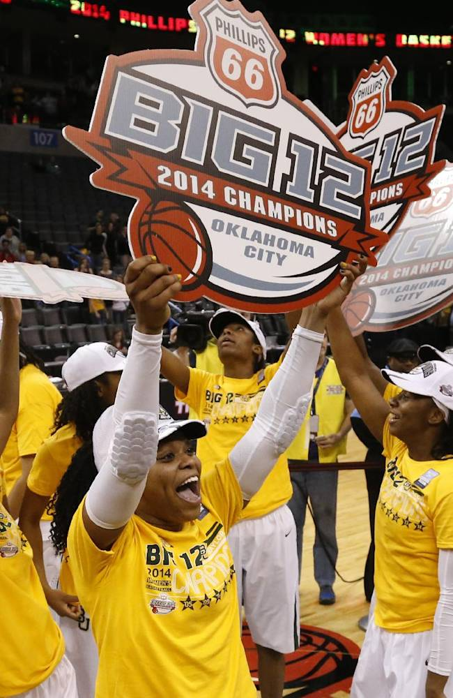 Baylor guard Odyssey Sims, center, celebrates with her team followings an NCAA college basketball game in the finals of the Big 12 Conference women's college tournament in Oklahoma City, Monday, March 10, 2014. Baylor won 74-71