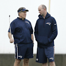 New England Patriots head coach Bill Belichick, left, talks with team chaplain Jack Easterby during practice Friday, Jan. 30, 2015, in Tempe, Ariz. The Patriots play the Seattle Seahawks in NFL football Super Bowl XLIX Sunday, Feb. 1 The Associated Press