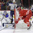 Carolina Hurricanes' Eric Staal, right, tries to score against St. Louis Blues goalie Jake Allen (34) during the second period of an NHL hockey game in Raleigh, N.C., Friday, Jan. 30, 2015 The Associated Press