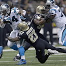 Carolina Panthers running back DeAngelo Williams (34) carries as New Orleans Saints free safety Malcolm Jenkins (27) tackles in the first half of an NFL football game in New Orleans, Sunday, Dec. 8, 2013 The Associated Press