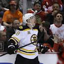 Boston Bruins left wing Jordan Caron (38) celebrates his goal during the first period of Game 3 of a first-round NHL hockey playoff series against the Detroit Red Wings in Detroit, Tuesday, April 22, 2014. (AP Photo/Carlos Osorio)