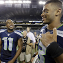 Seattle Seahawks' Percy Harvin (11) and Russell Wilson smile after the team defeated the Green Bay Packers 36-16 in an NFL football game, Thursday, Sept. 4, 2014, in Seattle The Associated Press
