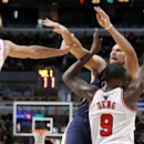 New Orleans Pelicans power forward Ryan Anderson, right, watches his shot as Chicago Bulls center Joakim Noah, left, and Luol Deng (9) defend during the second half of an NBA basketball game Monday, Dec. 2, 2013, in Chicago. The Pelicans won 131-128 in tr