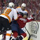 Philadelphia Flyers right wing Adam Hall, left, and Philadelphia Flyers center Zac Rinaldo (36) pull Washington Capitals center Jay Beagle to the ice during a scrum in the first period of an NHL hockey game on Sunday, March 2, 2014, in Washington The Asso