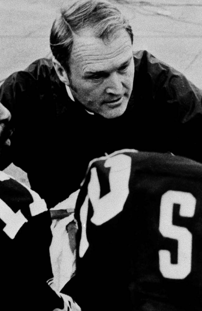 File-This Sept. 29, 1975, file photo shows Pittsburgh Steelers coach Chuck Noll conferring with quarterback Joe Gilliam, left, and wide receiver John Stallworth during game in Pittsburgh, Pa. Noll, the Hall of Fame coach who won a record four Super Bowl titles with the Pittsburgh Steelers, died Friday, June 13, at his home. He was 82. The Allegheny County Medical Examiner said Noll died of natural causes