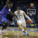 Memphis' Austin Nichols (4) powers past SMU's Yanick Moreira (2) in the first half of an NCAA college basketball game Thursday, Feb. 26, 2015, in Memphis, Tenn. (AP Photo/Karen Pulfer Focht)
