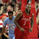 North Carolina State's Richard Howell (1) celebrates a basket ahead of North Carolina's Desmond Hubert (14) during the first half of an NCAA college basketball game in Raleigh, N.C., Saturday, Jan. 26, 2013. N.C. State won 91-83. (AP Photo/Ted Richardson)