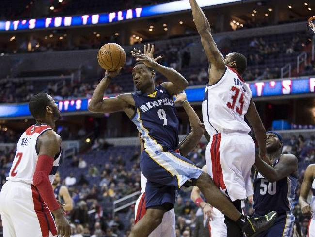 Memphis Grizzlies shooting guard Tony Allen (9) looks to pass the ball as he is defended by Washington Wizards point guard John Wall (2) and Washington Wizards forward Trevor Booker (35) during the first half of an NBA basketball game on Monday, March 3, 2014, in Washington