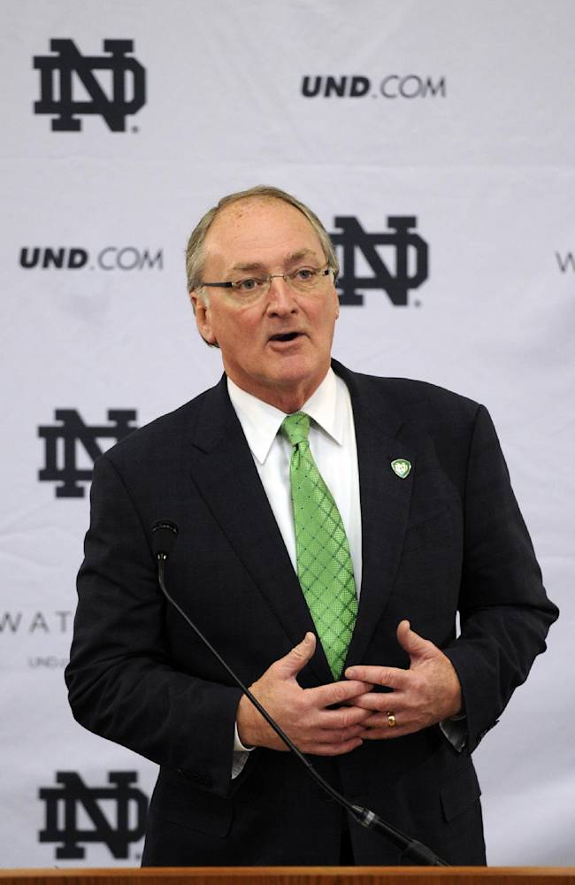 Jack Swarbrick, Notre Dame Vice President and Director of Athletics, speaks during a news conference Tuesday, Jan. 21, 2014, in South Bend, Ind., announcing an agreement between Notre Dame and Under Armour that will outfit the university's athletic teams