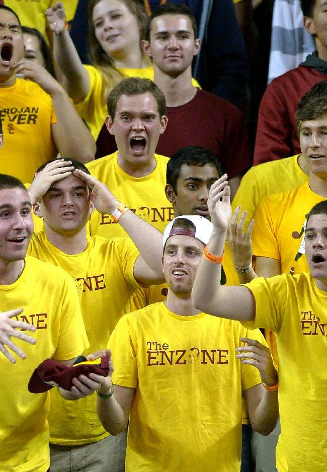 Southern California fans react as the ball was turned over to Arizona during the second half of an NCAA college basketball game, Sunday, Jan. 12, 2014, in Los Angeles