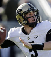 Purdue quarterback Danny Etling (5) passes during the first quarter of an NCAA college football game against Penn State in State College, Pa., Saturday, Nov. 16, 2013. (AP Photo/Gene J Puskar)