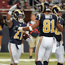St. Louis Rams running back Tre Mason, left, is congratulated by Kenny Britt after scoring on an 8-yard run during the fourth quarter of an NFL football game against the Oakland Raiders, Sunday, Nov. 30, 2014, in St. Louis The Associated Press