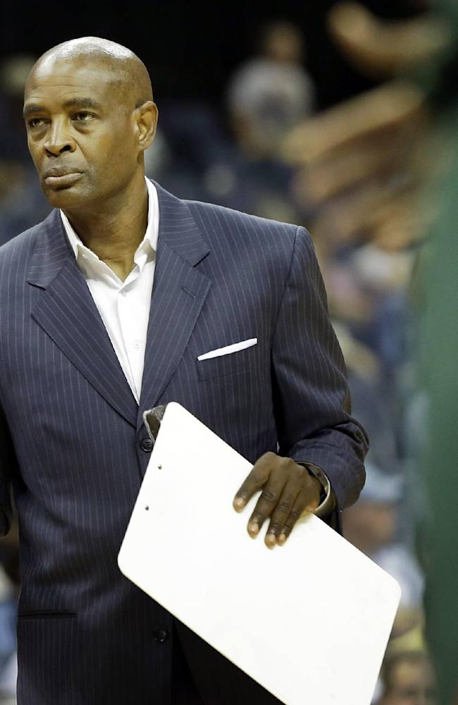 Milwaukee Bucks coach Larry Drew walks onto the floor during a timeout in the first half of an NBA preseason basketball game against the Memphis Grizzlies in Memphis, Tenn., Tuesday, Oct. 15, 2013. The Grizzlies won 102-99
