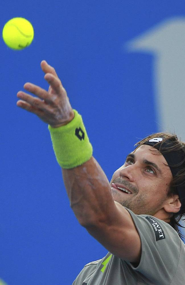 Spain's David Ferrer serves to Russia's Mikhail Kukushkin during a match of the Mexican Tennis Open championship in Acapulco, Mexico, Tuesday Feb. 25, 2014
