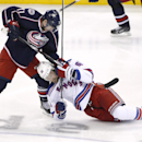 Columbus Blue Jackets' Matt Calvert (11) brings down New York Rangers' Rick Nash (61) at the beginning of the third period of an NHL hockey game, Friday, March 21, 2014, in Columbus, Ohio. A fight ensued after the take down The Associated Press