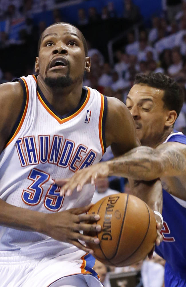 Los Angeles Clippers forward Matt Barnes, right, reaches in to knock the ball away from Oklahoma City Thunder forward Kevin Durant (35) in the second half of Game 5 of the Western Conference semifinal NBA basketball playoff series in Oklahoma City, Tuesday, May 13, 2014. Oklahoma City won 105-104. (AP Photo)