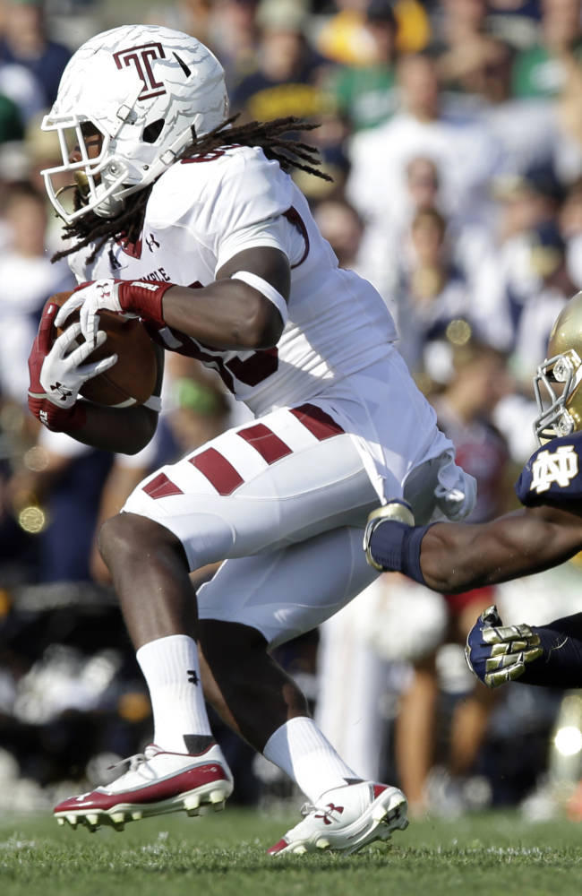 In this Aug. 31, 2013, file photo, Temple wide receiver Nate Hairston, left, is tackled by Notre Dame linebacker Jaylon Smith during the second half of an NCAA college football game in South Bend, Ind.  Smith, a freshman, and his junior teammate Jarrett Grace, have a common thread that binds them, comparisons to Manti Te'o