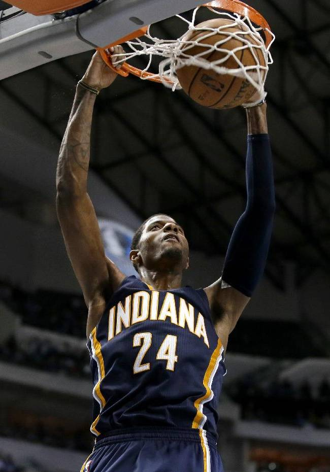 Indiana Pacers' Paul George dunks the ball against the Dallas Mavericks on a breakaway play in the second half of a preseason NBA basketball game Friday, Oct. 25, 2013, in Dallas