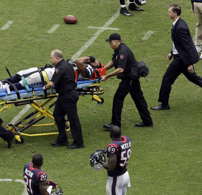 Seattle Seahawks' Michael Bennett is carted off the field after he was injured during the second quarter an NFL football game against the Houston Texans, Sunday, Sept. 29, 2013, in Houston