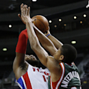 Detroit Pistons power forward Greg Monroe (10) drives on Milwaukee Bucks shooting guard Giannis Antetokounmpo (34), of Greece, in the third quarter of an NBA basketball game in Auburn Hills, Mich., Monday, Nov. 25, 2013 The Associated Press