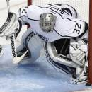 Los Angeles Kings goalie Jonathan Quick (32) blocks a goal attempt against San Jose Sharks during the third period in Game 3 of their second-round NHL hockey Stanley Cup playoff series, Saturday, May 18, 2013, in San Jose, Calif. (AP Photo/Tony Avelar)