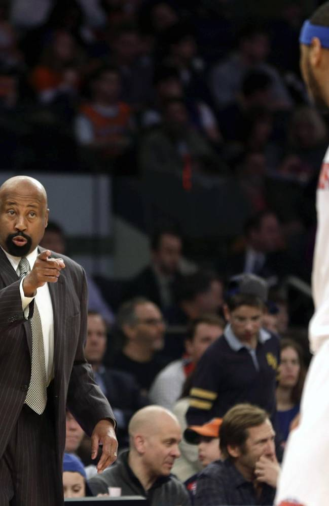 New York Knicks' head coach Mike Woodson, left, talks with Carmelo Anthony during the second half of an NBA basketball game at Madison Square Garden, Sunday, Jan. 26, 2014, in New York. The Knicks defeated the Lakers 110-103