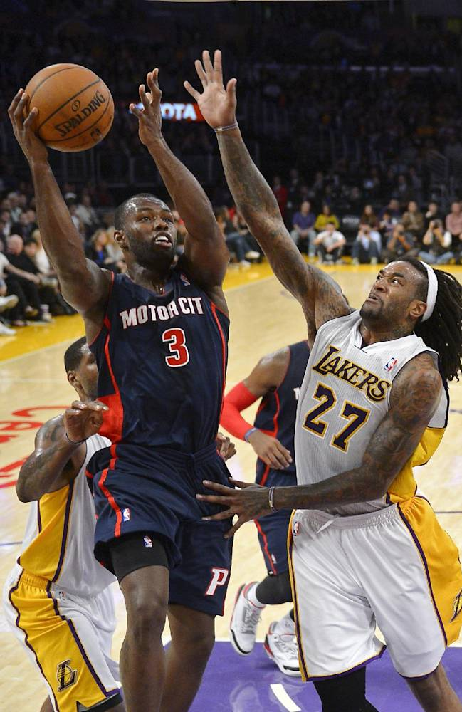 Detroit Pistons guard Rodney Stuckey, left, puts up a shot as Los Angeles Lakers center Jordan Hill defends during the first half of an NBA basketball game Sunday, Nov. 17, 2013, in Los Angeles