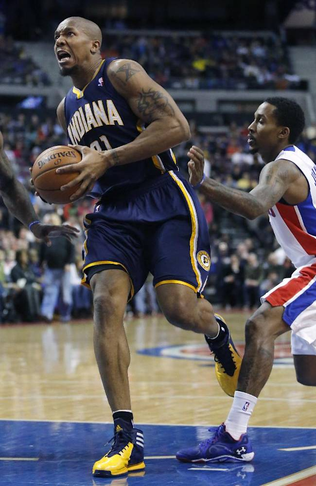 Indiana Pacers forward David West, left, goes to the basket past Detroit Pistons guard Brandon Jennings during the first half of an NBA basketball game Saturday, March 15, 2014, in Detroit