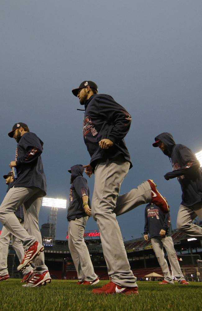 The St. Louis Cardinals stretch before Game 1 of baseball's World Series against the Boston Red Sox  Wednesday, Oct. 23, 2013, in Boston