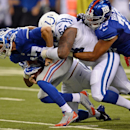 New York Giants quarterback Curtis Painter (17) is sacked by Indianapolis Colts' Zach Kerr (64) during the second half of an NFL preseason football game Saturday, Aug. 16, 2014, in Indianapolis The Associated Press