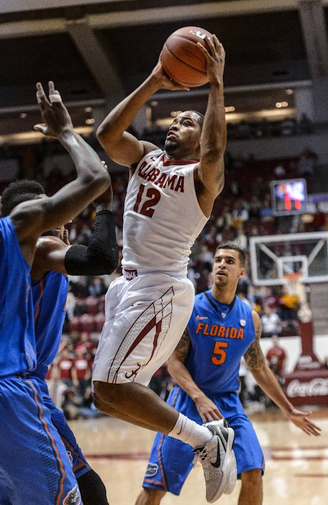 Alabama guard Trevor Releford (12) gets loose under the basket during an NCAA college basketball game against Florida on Thursday, Jan. 23, 2014, at Coleman Coliseum in Tuscaloosa, Ala