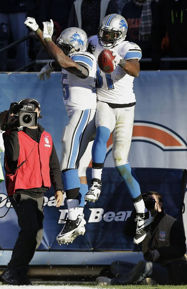 Detroit Lions wide receiver Calvin Johnson (81) celebrates his touchdown reception against the Chicago Bears with running back Joique Bell (35) during the second half of an NFL football game, Sunday, Nov. 10, 2013, in Chicago