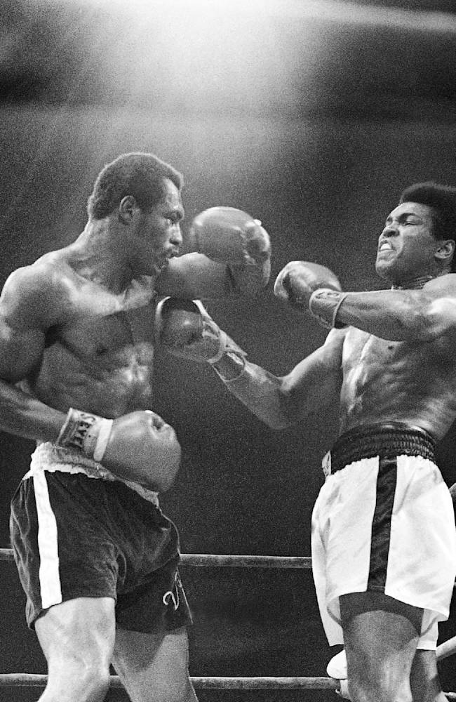 In this Sept. 10, 1973, file photo, Muhammad Ali, right, winces as Ken Norton hits him with a left to the head during their re-match at the Forum in Inglewood, Calif. Norton, a former heavyweight champion, has died, his son said, Wednesday, Sept. 18, 2013. He was 70