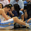 DENVER, CO - APRIL 04: Danilo Gallinari #8 of the Denver Nuggets grimaces as he injures his left leg and was forced to leave the game against the Dallas Mavericks at the Pepsi Center on April 4, 2013 in Denver, Colorado. (Photo by Doug Pensinger/Getty Images)